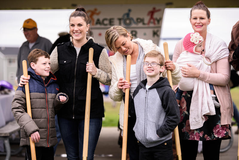 Amanda Weichers and her son Beau (left) smile at the groundbreaking ceremony for the new park in Cedar Falls.