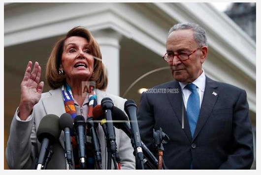 House Speaker-designate Nancy Pelosi of California, left, and Senate Minority Leader Chuck Schumer, D-N.Y., speak to the media after meeting with President Donald Trump, Wednesday, Jan. 2, 2019, on border security at the White House
