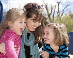"""Jane Roper, Iowa Writer's Workshop graduate and author of the book """"Double Time"""" and her twin daughters."""