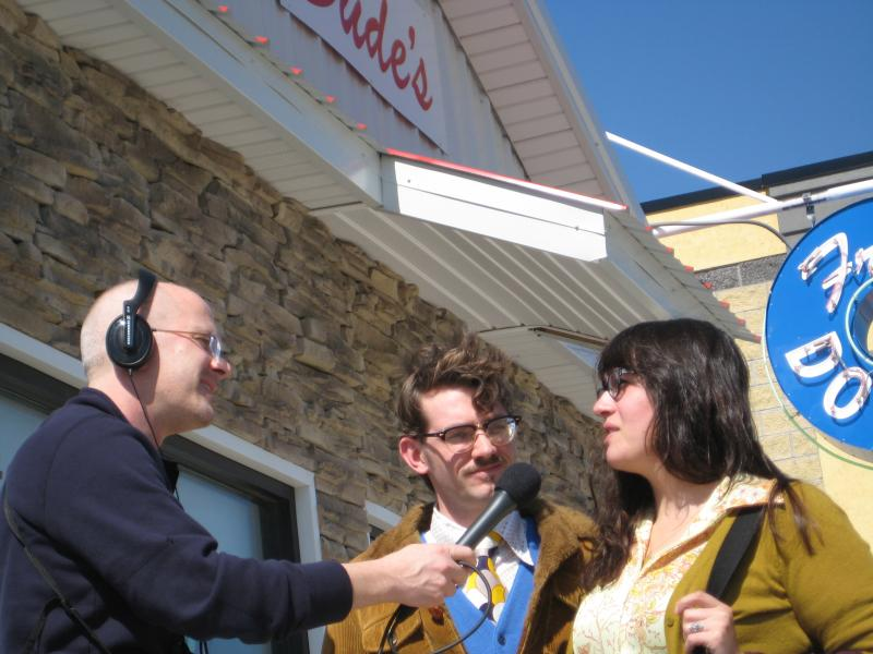 IPR's Ben Kieffer interviewing survivors Ian Coday and Martha Goldman outside the newly rebuilt Dude's Daylight Donuts in Joplin. Both the donut shop and the couple's house were destroyed by the EF5 tornado that struck May 22, 2011, killing 160 people.