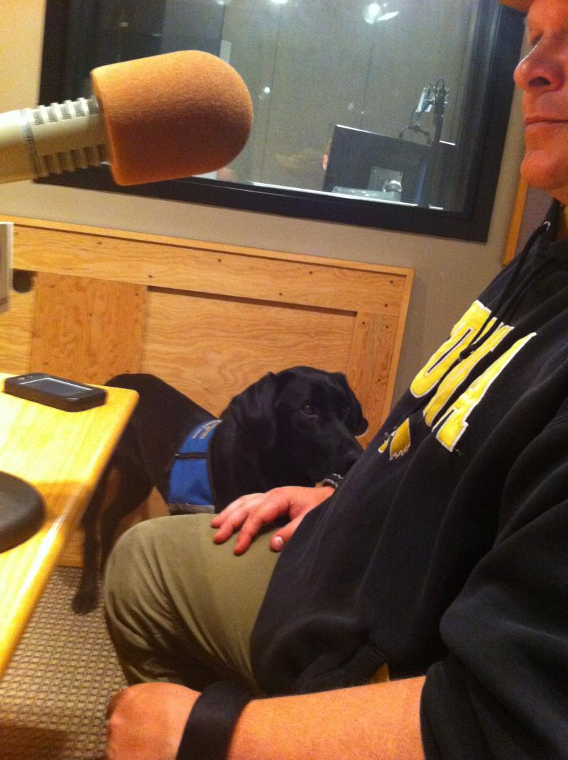 Honor the service dog sitting by the side of Sgt. Wade Baker in the IPR studios