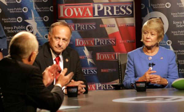 Republican Incumbent Steve King and Christie Vilsack listen to debate moderator Dean Borg.