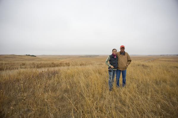 Lindsey Price and father Bob Price look out on the land of their Gracie Creek Ranch near Burwell, in central Nebraska.The Price family recently sold the largest conservation easement in Nebraska history, covering about 40 square miles.