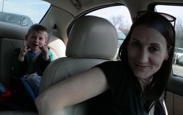 Rachel Fredericksen and her son Gage sit in their car outside her son Shawn's elementary school in Clinton on April 5, 2013.