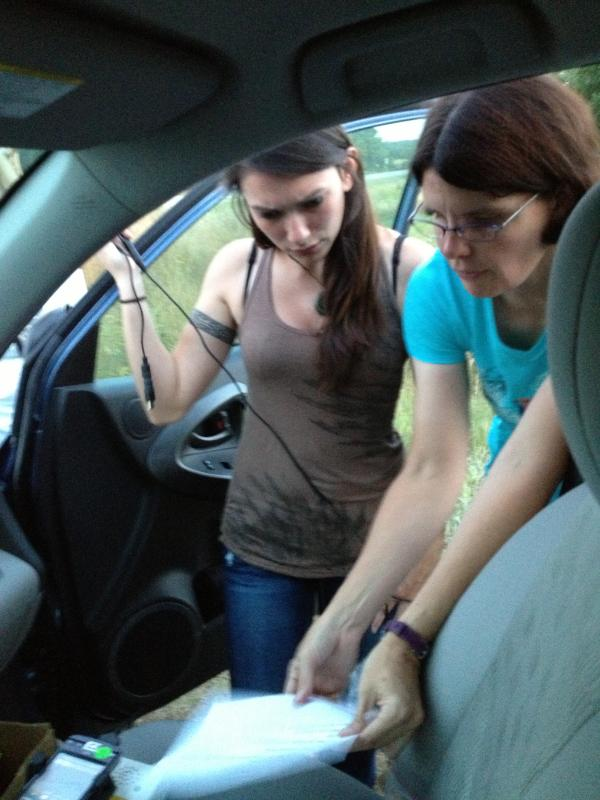 Dr. Julie Blanchong, an associate professor in ISU's Department of Natural Resource Ecology and Management (right), works with a student to set up a recording device used to capture bat calls.