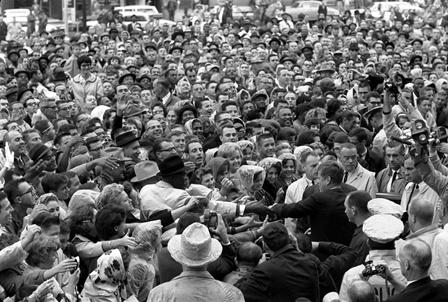President Kennedy reaches out to the crowd gathered at the Hotel Texas Parking Lot Rally in Fort Worth, TX, 22 November 1963