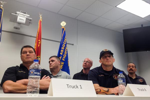 During a press conference, members of the Des Moines Fire Department share their experiences of responding to last weekend's Younkers Building fire.