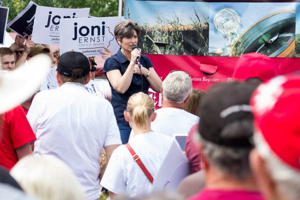 At the Iowa State Fair, Republican candidate for an Iowa US Senate seat Joni Ernst speaks to a crowd at the Des Moines Register's political soapbox.
