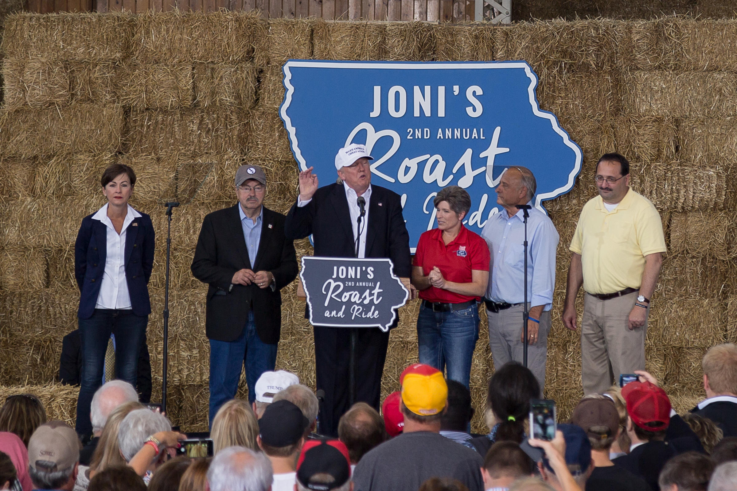 Republican presidential candidate Donald Trump appears on stage with Iowa Lieutenant Governor Kim Reynolds Governor Terry Branstad Sen. Joni Ernst Congressman Steve King and Iowa GOP Chairman Jeff Kaufmann