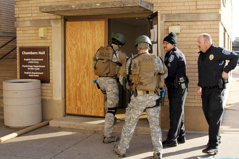 Abilene Police officers prepare for a drill Wednesday, January 7, 2015 at Chambers Hall on the campus of Abilene Christian University.