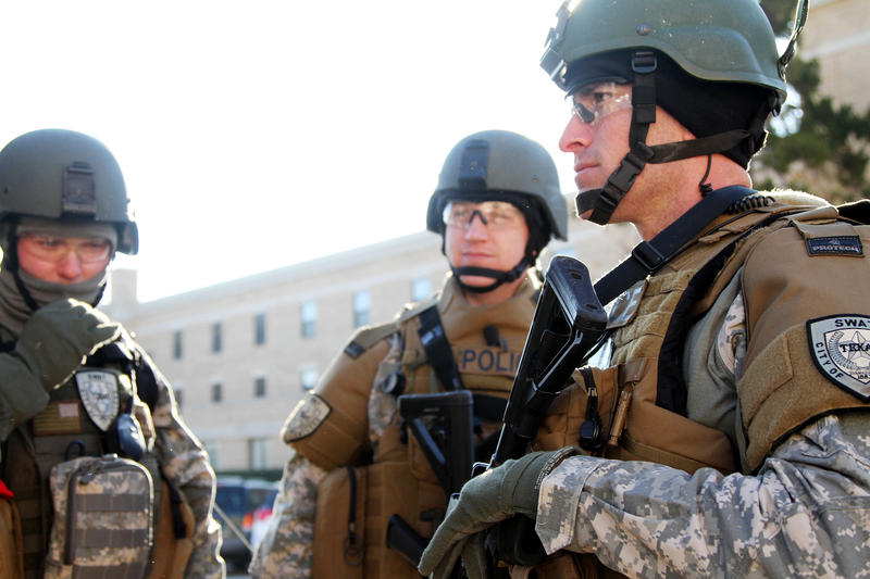 Abilene Police SWAT members prepare for a drill Wednesday, January 7, 2015 at Chambers Hall on the campus of Abilene Christian University.