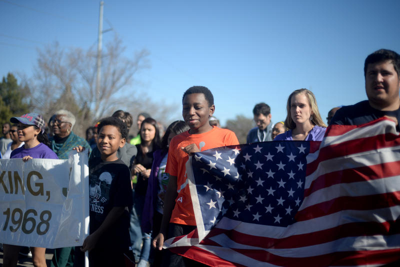 Participants in the Martin Luther King Jr. Walk make their way across the Martin Luther King Jr. Bridge Monday, January 19, 2015.