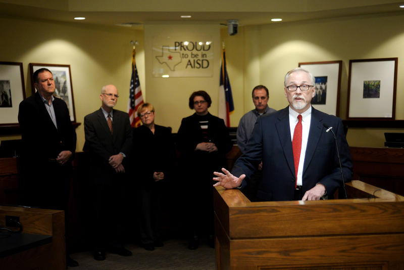 Abilene ISD School Board President Danny Wheat describes the terms of the resignation of former superintendent Heath Burns during a news conference Wednesday at the AISD office.