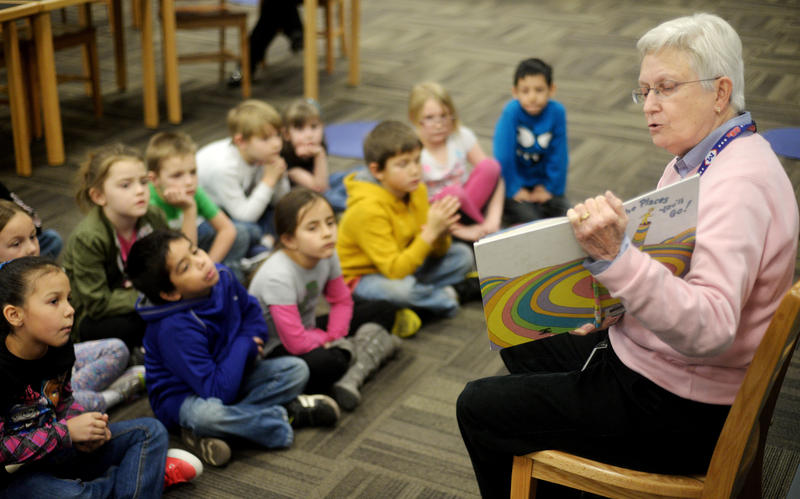 "Connie Mangin, AISD Executive Director of Special Education, reads ""Oh The Places You'll Go,"" to students at Martinez Elementary School Monday, March 2, 2015."
