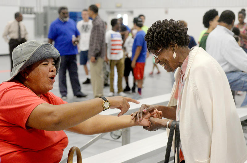 (Photo by Joy Bonala) Glenda Washington, left, greets Imogene Lott during the Juneteenth Celebration Friday, June 19, 2015 at the G.V. Daniels Recreation Center.