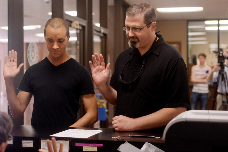 (Photo by Joy Bonala) David McDonald, left, and his partner of 14 years, Troy Bonar, receive their marriage license Tuesday, June 30, 2015 at the Taylor County Courthouse.