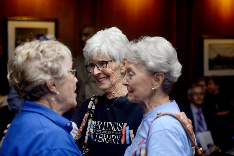 (Photo by Joy Bonala) Members of the organization, Friends of The Abilene Public Library, celebrate Thursday after members of the Abilene City Council vote to move the library's south branch to the Mall of Abilene.