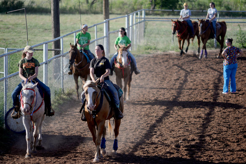 (Photo by Joy Bonala) Members of the Freedom Fliers drill team practice Monday, July 13, 2015 at the Taylor County Sheriff Posse Arena.