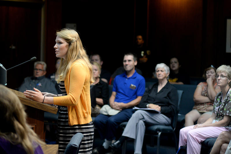 (Photo by Joy Bonala) Melissa Mason speaks in opposition to a proposed animal ordinance during an open hearing Thursday, August 27, 2015 at City Hall.