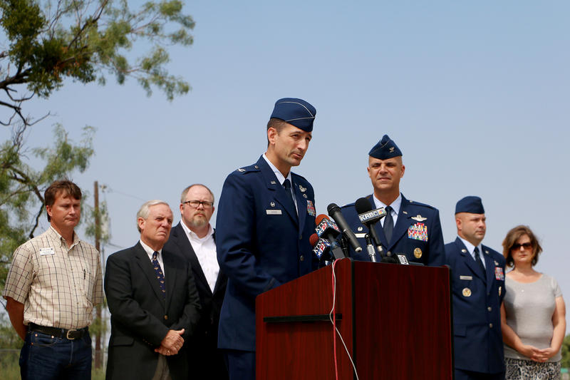 (Photo by Joy Bonala) Col. Stephen Hodge, 317th AG Commander, confirms the death of four Airmen assigned to the 317th AG after their C-130J crashed in Afghanistan on Friday, October 2, 2015.
