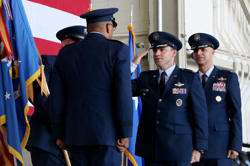 (Photo by Joy Bonala/KACU) Col. David Benson, center, assumes command of the 7th Bomb Wing after Col. Michael Bob Starr, right, relinquished command Thursday, October 29, 2015 at Dyess Air Force Base.