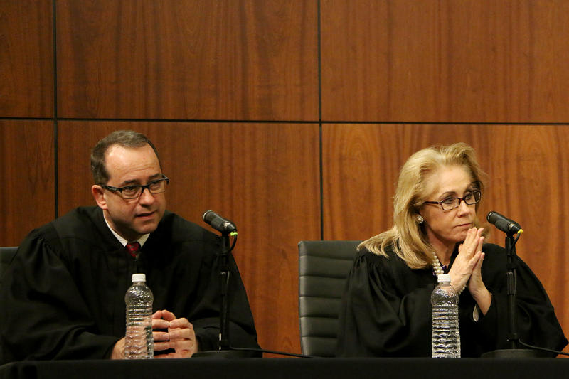 (Photo by Joy Bonala/KACU)  Texas Supreme Court Justice John P. Devine, left, and Justice Debra H. Lehrmann answer questions from the audience  Friday, November 13, 2015 at Abilene Christian University.