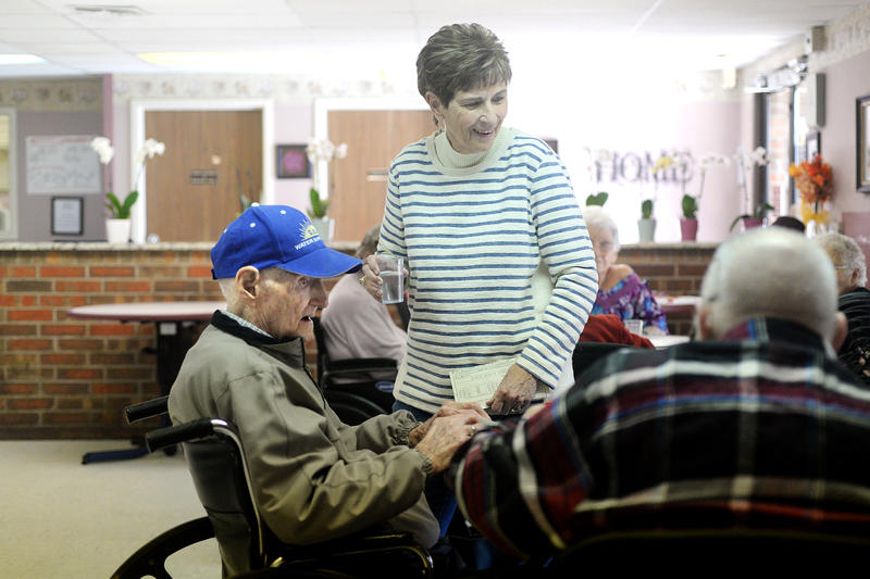 (Photo by Joy Bonala)  Ivy Paul Lucas joins in a game of Bingo while his niece and care-giver, Jeaneatte Pursley, serves him water and coffee Wednesday, January 13, 2016 at the Merkel Nursing Center.