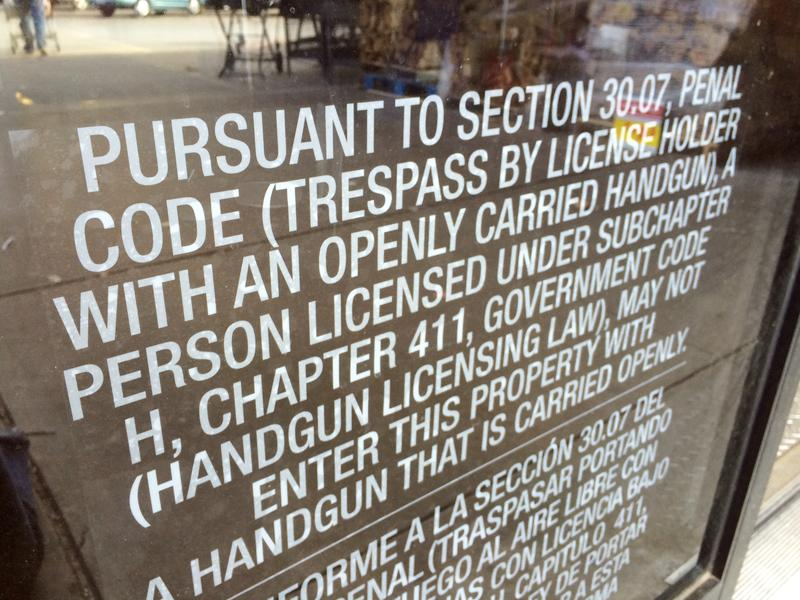 (Photo by Joy Bonala) Signs like this one are posted at the entrances of businesses in Abilene and across Texas regarding rules on open carry.