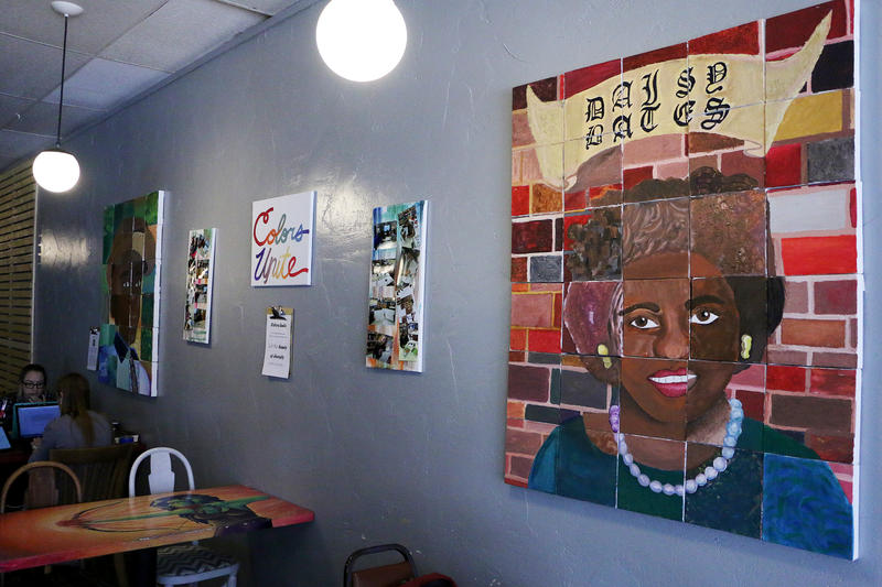 "(Photo by Joy Bonala) The ""Colors Unite"" art exhibit by Clack Middle School students will be on display through February at Monks Coffee Shop in Abilene. The exhibit features portraits of Emmitt Till and Daisy Bates."