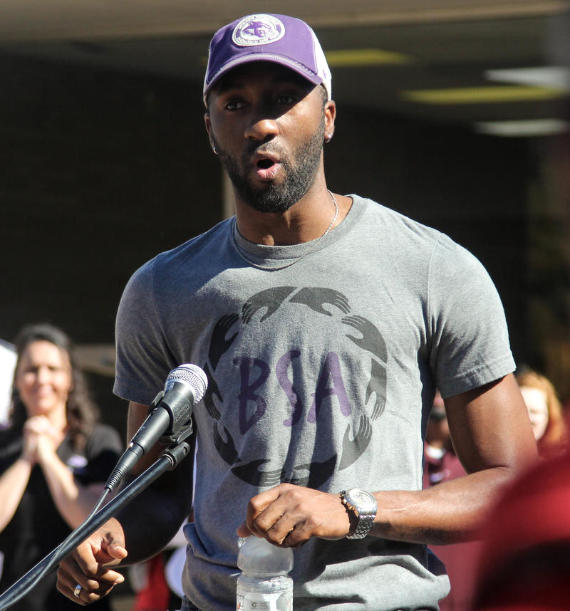 (Photo by Lydia Lawson) Khamisie Green speaks to a crowd gathered outside of ACU's Campus Center about race issues.