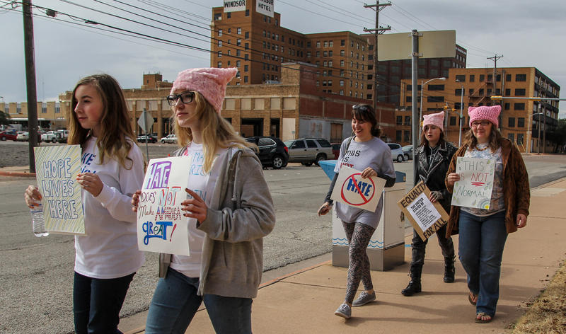 Women, men and families march around Abilene's City Hall in solidarity with the Women's March on Washington. (Photo by Lydia Lawson)
