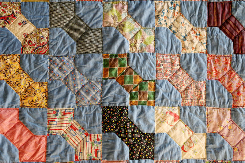 (Joy Bonala/KACU) A quilt made by Nellie Jane Carnes Burnett of Wills Point, Texas. She made the quilt out of chicken feed sacks in the 1930's.