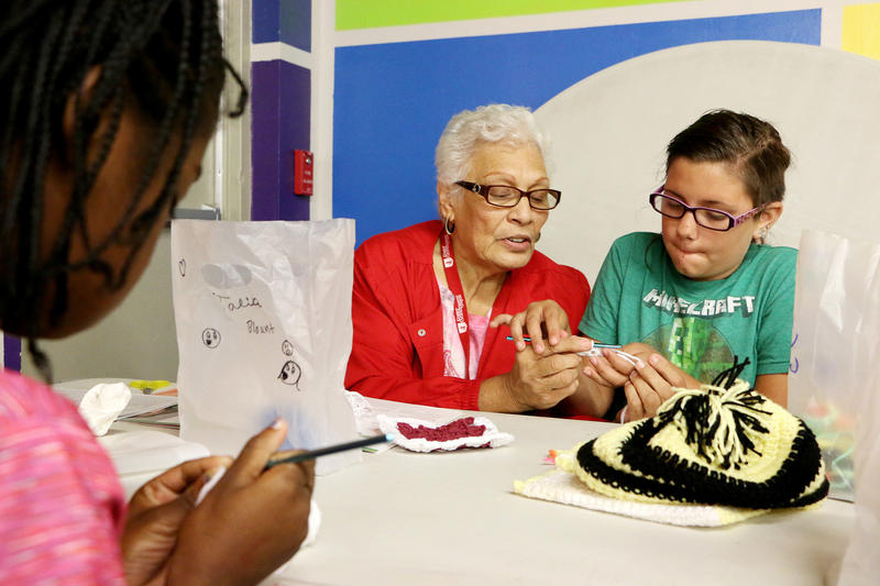 (Joy Bonala/KACU) Foster Grandparent Marian Rivas teaches crochet Tuesday, June 27, 2017 at the Martinez Boys and Girls Club in Abilene.