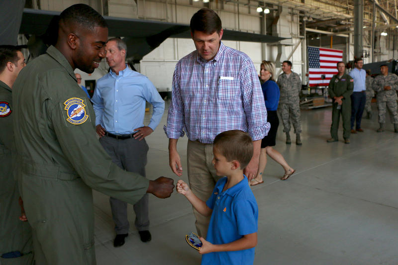 District 13 Rep. Mac Thornberry, second from left, meets Dyess Airmen along with fellow congressman Jodey Arrington and his son, Nathan.