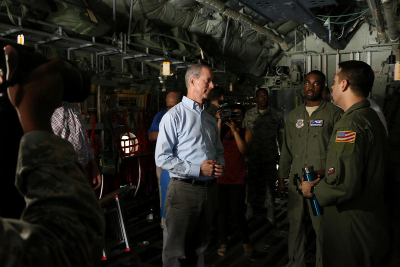 District 13 Rep. Mac Thornberry, center, tours a C-130J along with fellow Republican Jodey Arrington.