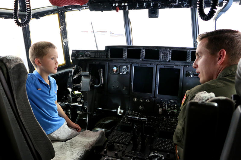 Congressman Jodey Arrington's son, Nathan, talks with Capt. Jesse Mouton about how to fly a C-130J.