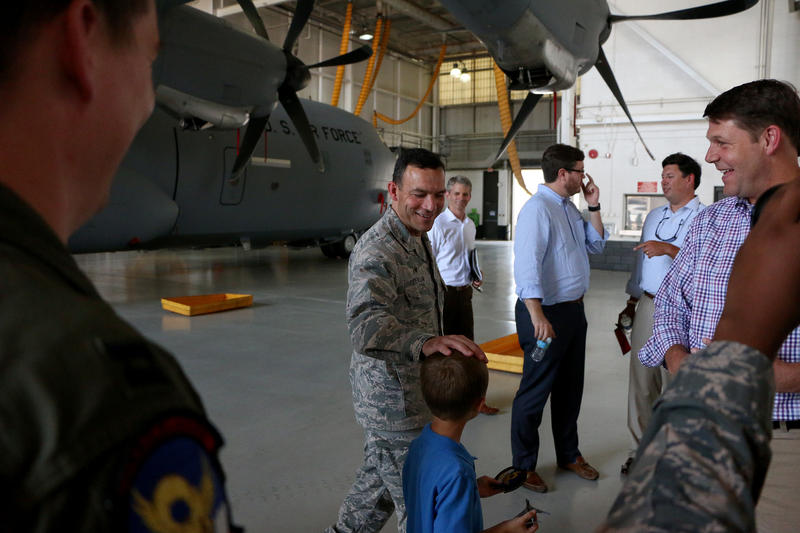 Outgoing Dyess Commander Col. David Benson, center, guides Congressman Jodey Arrington and his son, Nathan, through a tour of Dyess aircraft.