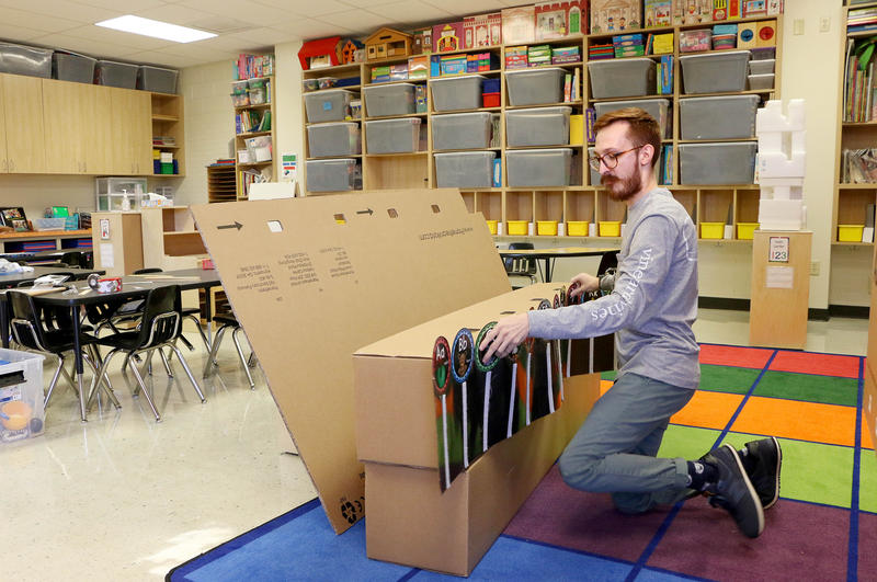 (Joy Bonala/KACU) Jeremy Bartley organizes his classroom at Long Early Learning Center before the start of the new school year.
