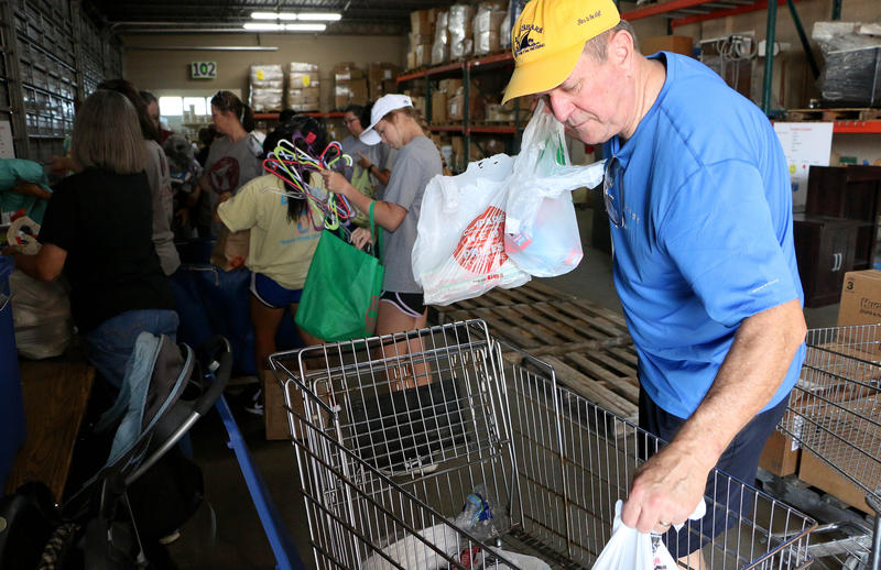 (Joy Bonala/KACU) State Rep. Stan Lambert helps pack supplies for victims of Hurricane Harvey on Friday, September 1, 2017 at Global Samaritan Resources.