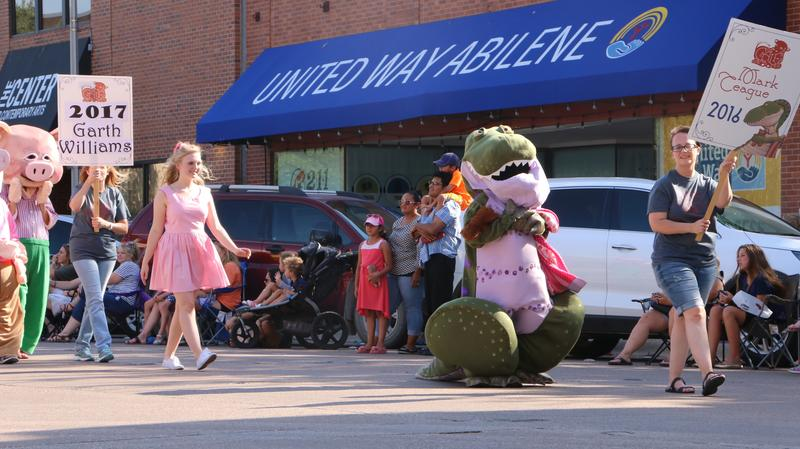 Participants walk in the Children's Art and Literacy Festival parade through downtown Abilene on June 7, 2018.