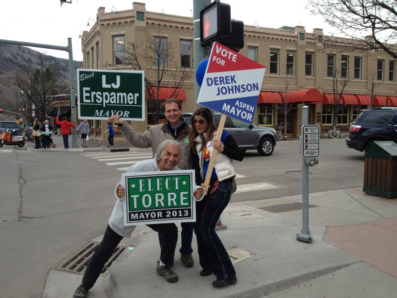 Mayoral candidate LJ Erspamer, and supporters of his opponents, campaign at Mill and Main on Tuesday, May 7th.