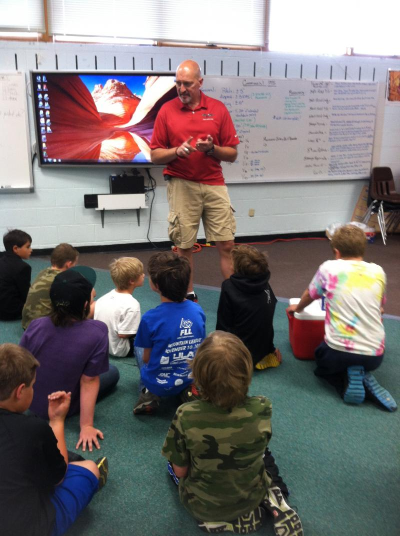 Greg Roark teaches aviation and aeronautics to a group of third and fourth grade students at Aspen Elementary School.
