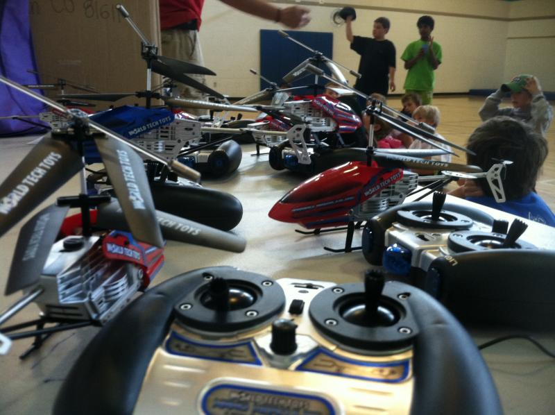 For one of their classes, a group of elementary school students flew remote controlled helicopters.