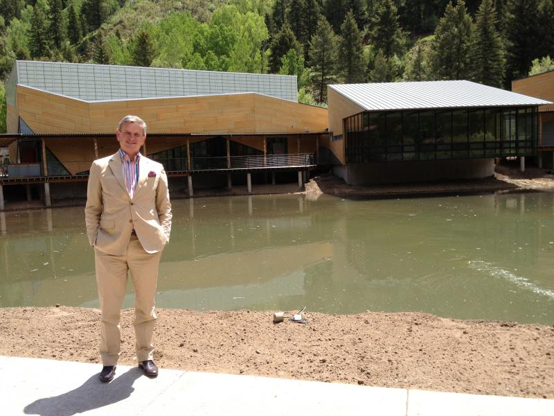 Alan Fletcher, President and CEO of the Aspen Music Festival and School, stands in front of the Edlis Neeson Rehearsal Hall and two other nearly completed buildings on the new campus.