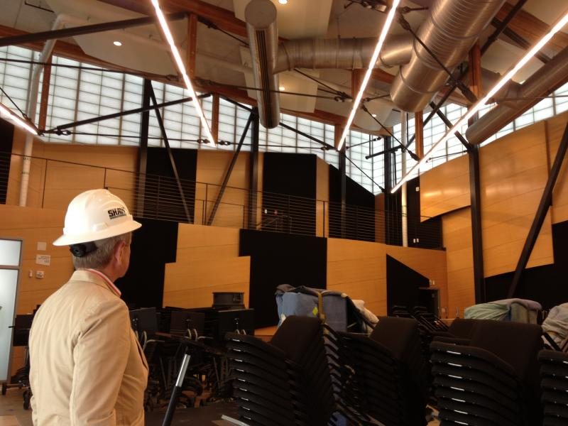 Alan Fletcher, President and CEO of the Aspen Music Festival and School, looks at the innards of the Edlis Neeson Rehearsal Hall.