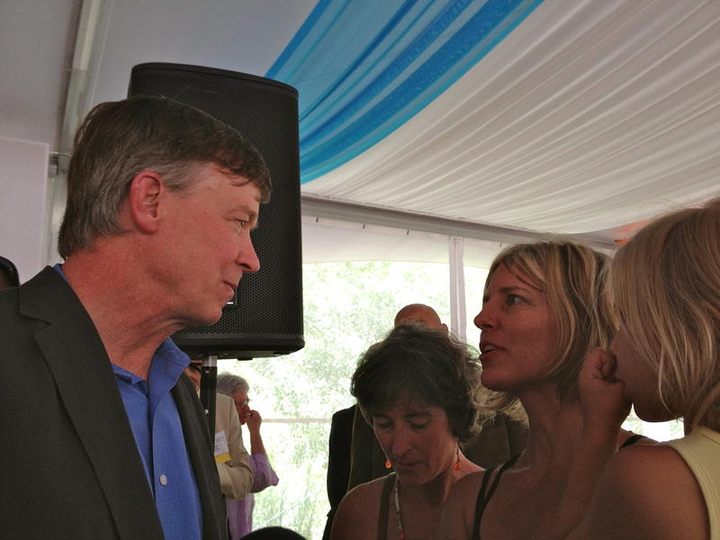 Governor John Hickenlooper talks with Telluride resident Allison Wolff of Frack-Free Colorado. Photo taken at the Aspen Institute's Greenwald Pavilion.