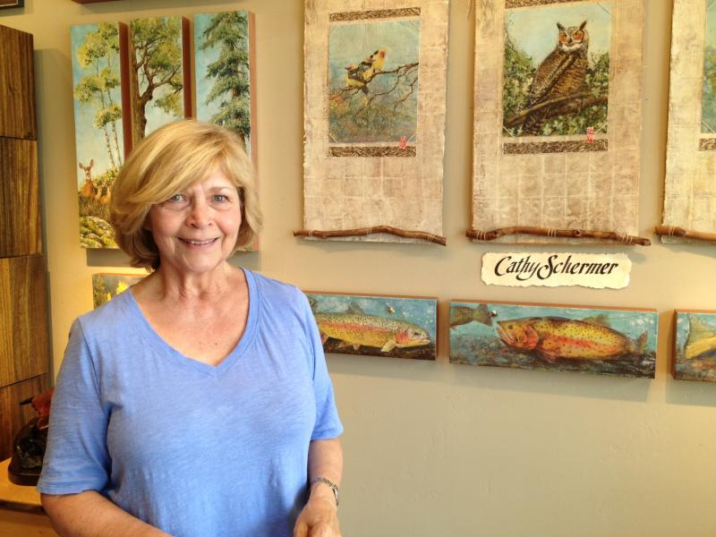 Artist Cathy Schermer stands in front of her collection in the Toklat Gallery.