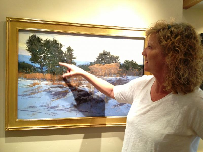Artist Dinah Worman explaining the inspiration behind one of her works on display at the Ann Korologos Gallery.