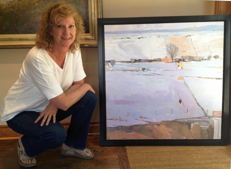 Dinah Worman with her oil painting, History of a Field. The piece took Best of Show at the 2013 Coors Art Show.