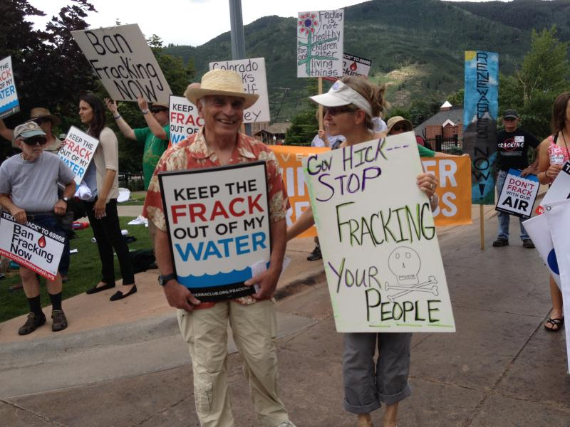 Marsha Miller, of Denver, and Bob Bogner participate in the protest Saturday across from the St. Regis Hotel.